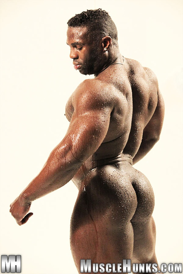 Athletic african man showing naked muscular body stock image