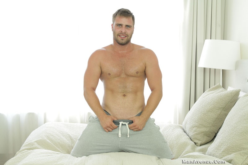 Handsome stud Marco Phoenix strips naked and jerks his big dick