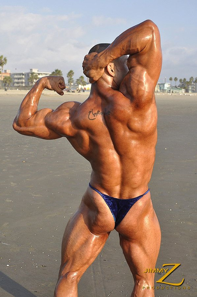 JimmyZProductions-Alavi-Damante-bodybuilder-muscles-oiled-ripped-body-thong-glutes-naked-cigar-smoking-006-male-tube-red-tube-gallery-photo