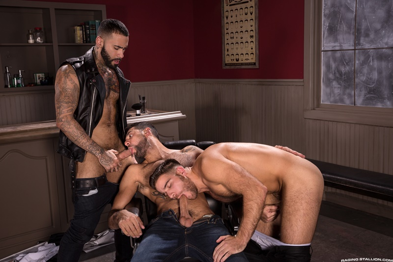 Jackson Grant fucks Rikk York's face while Mick Stallone stands up and plows Rikk's hairy hole with his hard cock