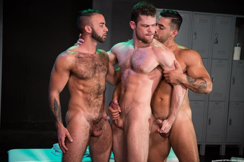 Fernando Del Rio and Arad Winwin take turns servicing Kurtis Wolfe's huge cock and fingering his ass