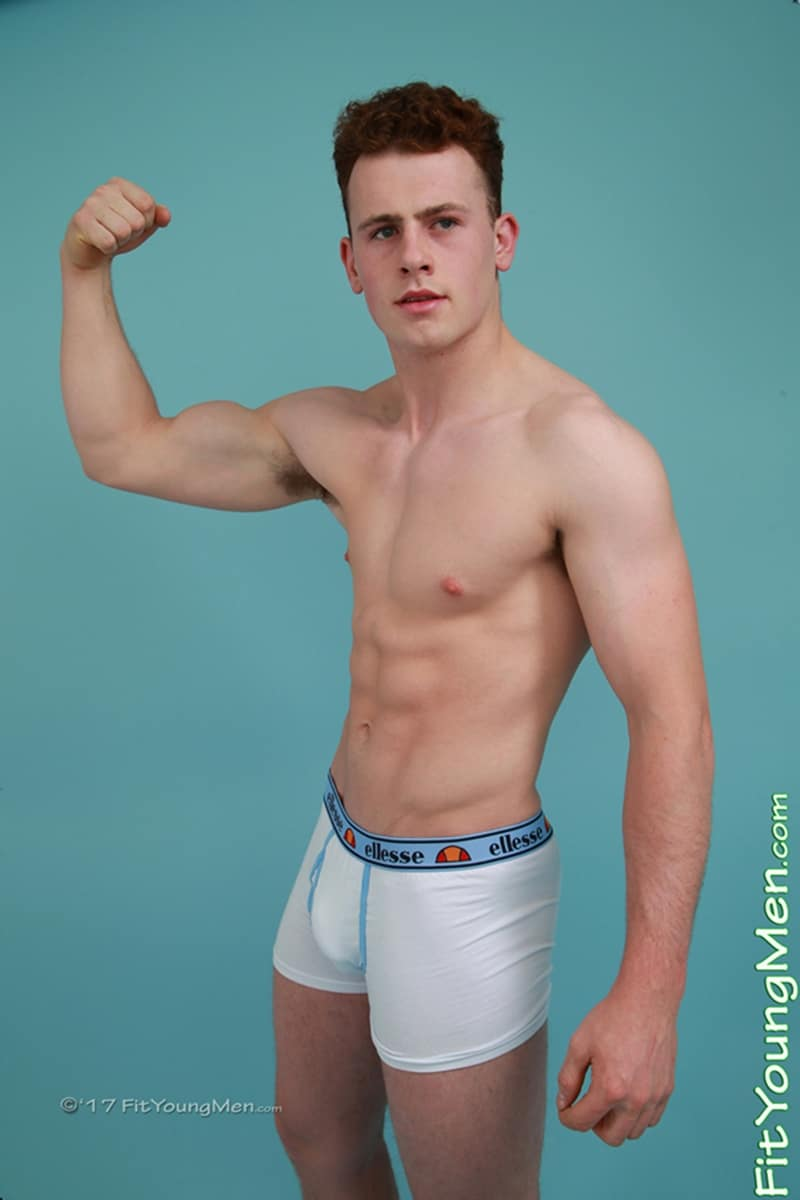 Ripped-young-muscle-stud-Tom-Stevens-strips-football-kit-wanking-big-uncut-dick-FitYoungMen-004-Gay-Porn-Pics