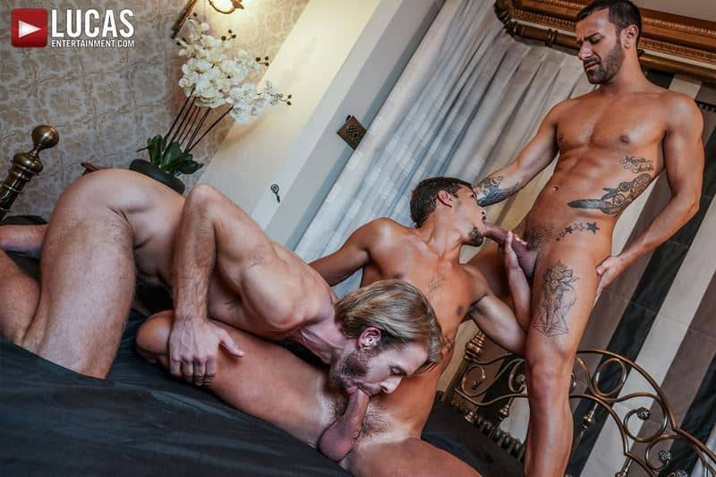 Horny muscle hunks Gustavo Cruz and Gabriel Phoenixs' huge uncut dicks bareback fuck Ray Crosswell's holes